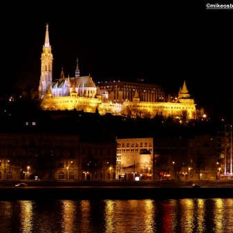An illuminated part of Castle Hill, including the Matthias Church to the left