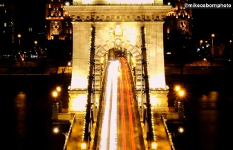 The Chain Bridge at night, streaming with traffic