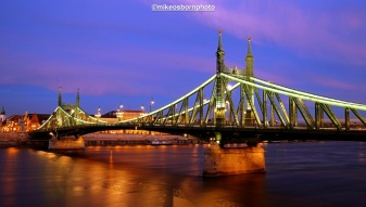 Freedom Bridge at dusk. The ornate green structure should be twinned with London's Hammersmith Bridge