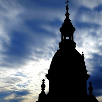 Part of St Stephen's cathedral silhouetted against a winter sky