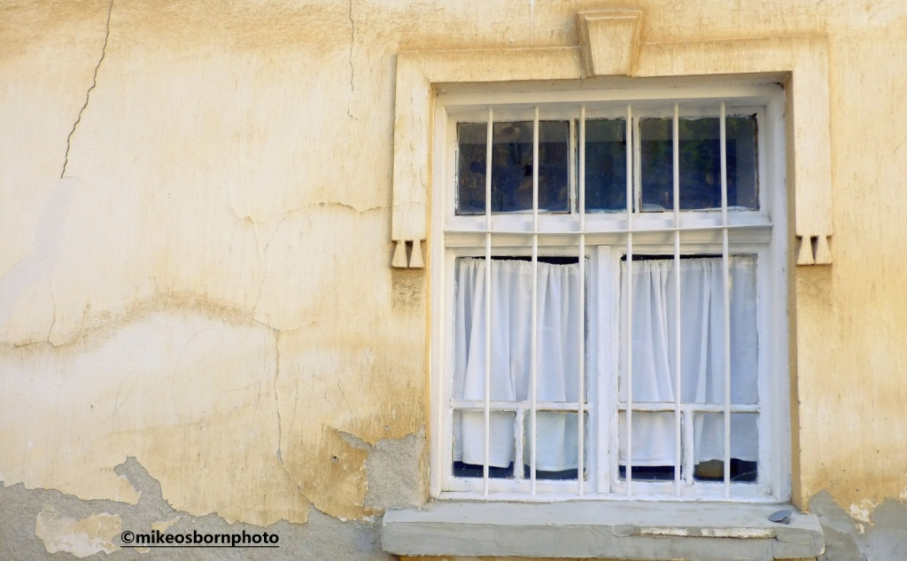 A crooked old window in Ohrid, North Macedonia
