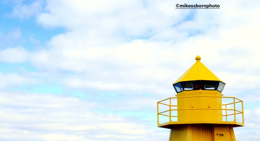 A yellow lookout post in Reykjavik harbour, Iceland