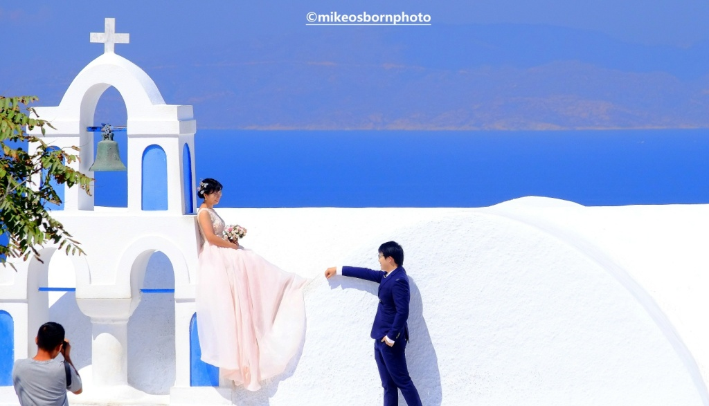 Newlyweds in Oia, Santorini, Greece