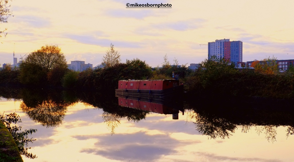 Red narrow boat on Bridgewater Canal, Manchester