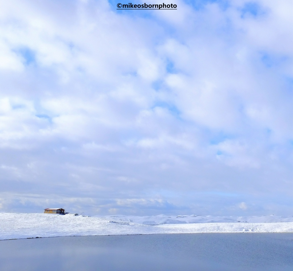 Snowy scene by a lake in Iceland