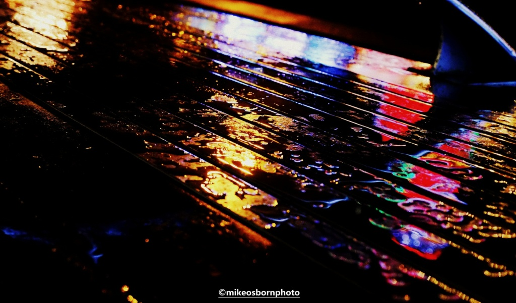 Rain reflects Christmas lights in Piccadilly Gardens, Manchester