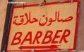 Barber's sign in Muscat souk, Oman
