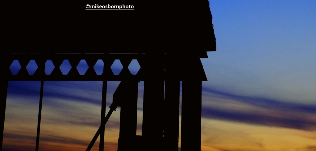 Dusk over Castlefield and silhouette of iron stairway