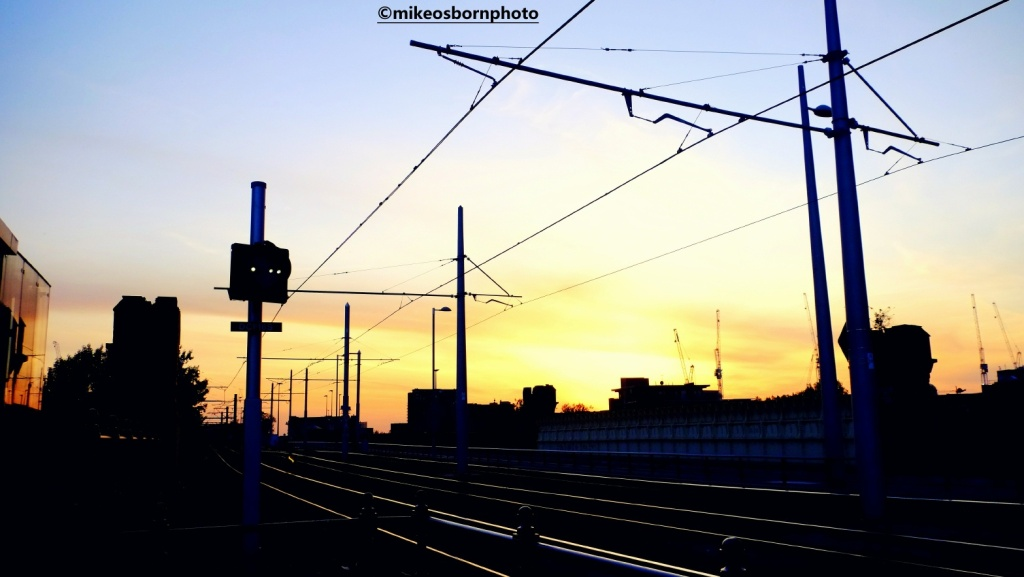 Manchester tram lines at sunset