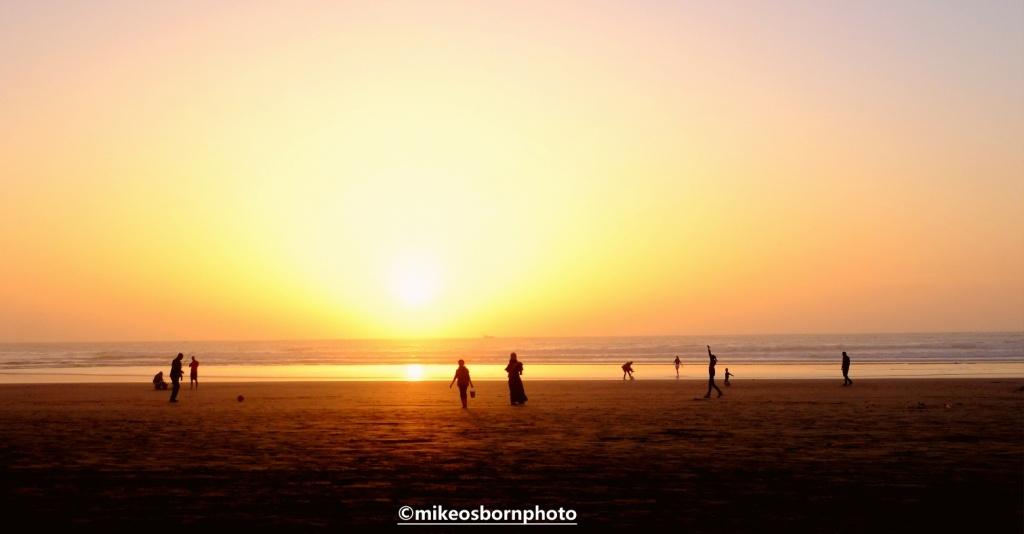 People on Agadir beach at sunset
