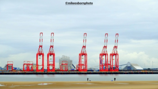 Red cranes on the Mersey estuary at New Brighton
