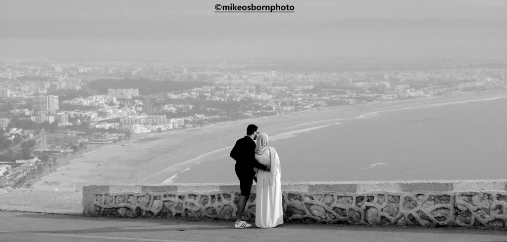 Moroccan couple overlook the Moroccan city of Agadir
