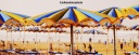 Brightly coloured parasols on Agadir beach, Morocco