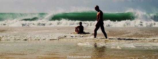Bathers in crashing waves at Boa Vista, Cape Verde