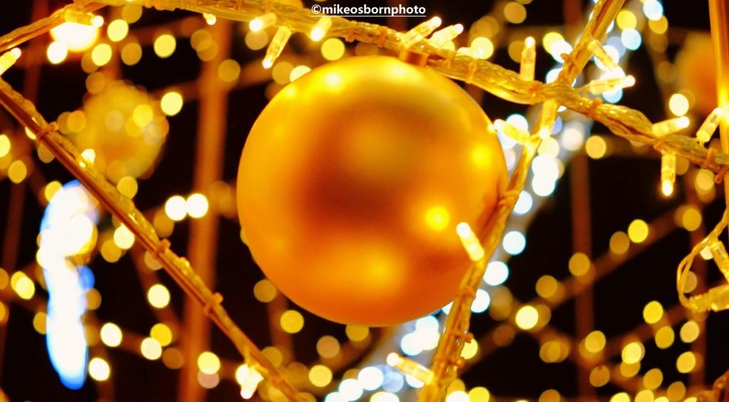 Golden bauble, Christmas light and bokeh
