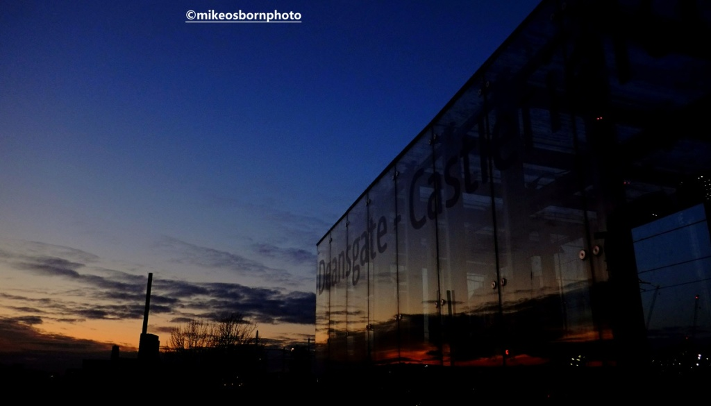Sunset turns into night at Deansgate-Castlefield tram stop, Manchester