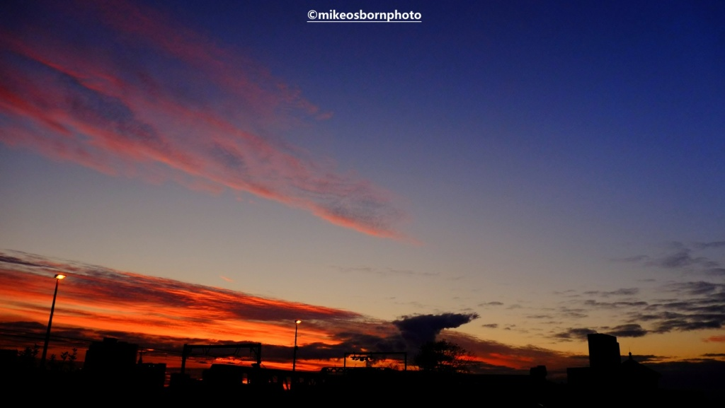 A fiery sunset seen from Deansgate walkway in Manchester