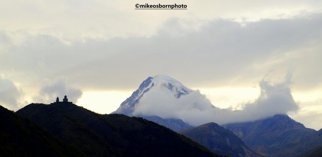 View of mountains and monastery of Kazbegi, Georgia