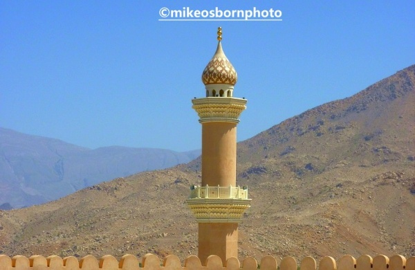 Minaret and fort wall in Oman