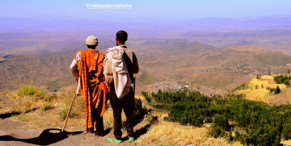 Two Ethiopian men take in the view over countryside near Lalibela