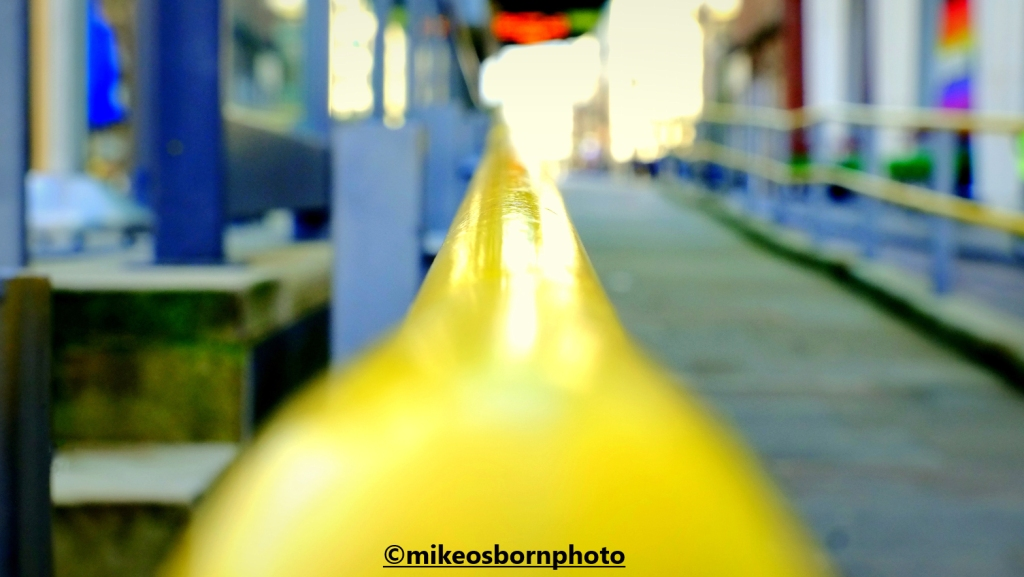 Yellow handrail of St Peter's Square tram station, Manchester