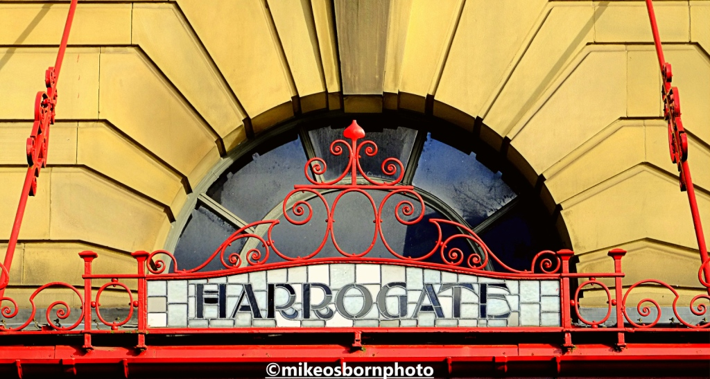 Sign for Harrogate on Victoria Station, Manchester