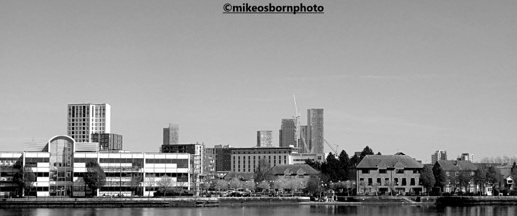 The towers of Manchester city centre as seen from Salford Quays