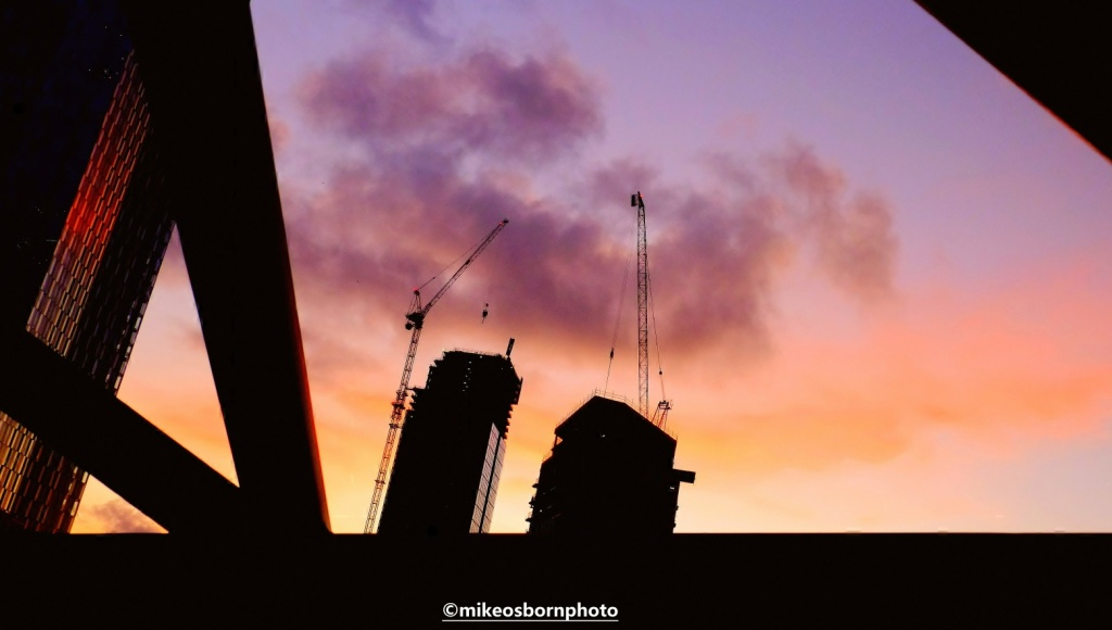 Manchester sunset frames skyscrapers under construction