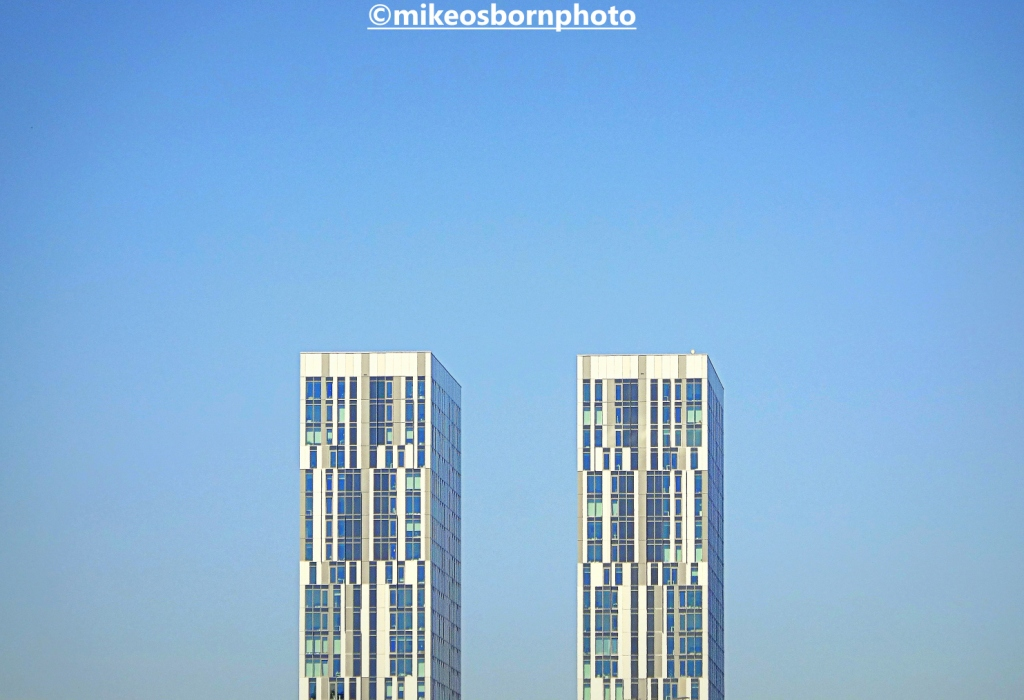 Tower blocks of Harbour City, Salford against a clear blue sky