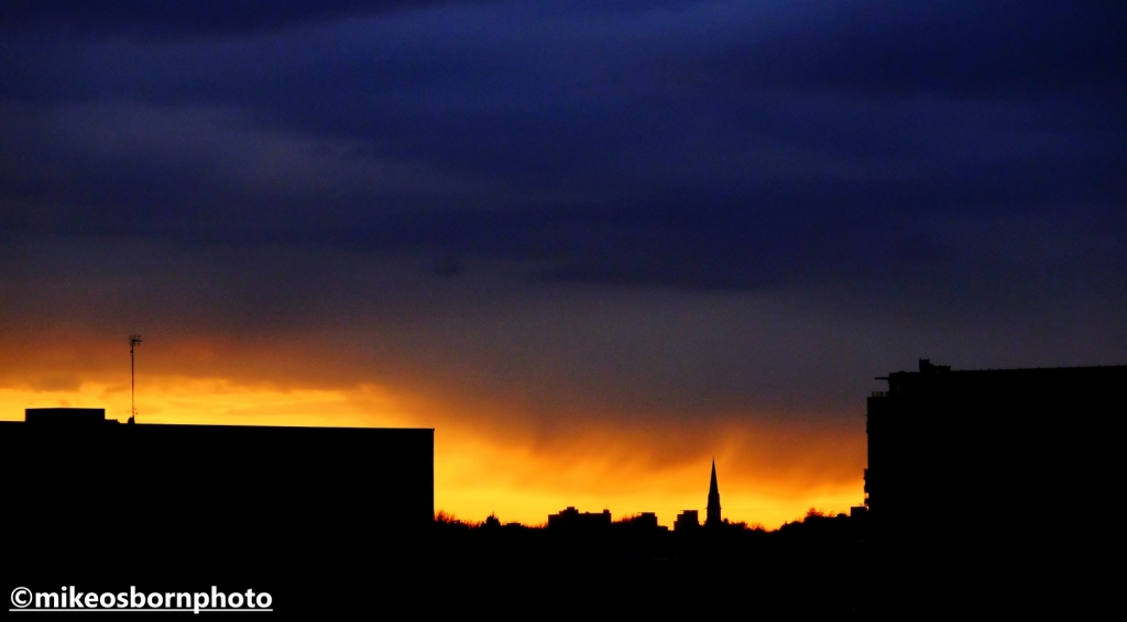 Sunset over Salford on a rainy evening