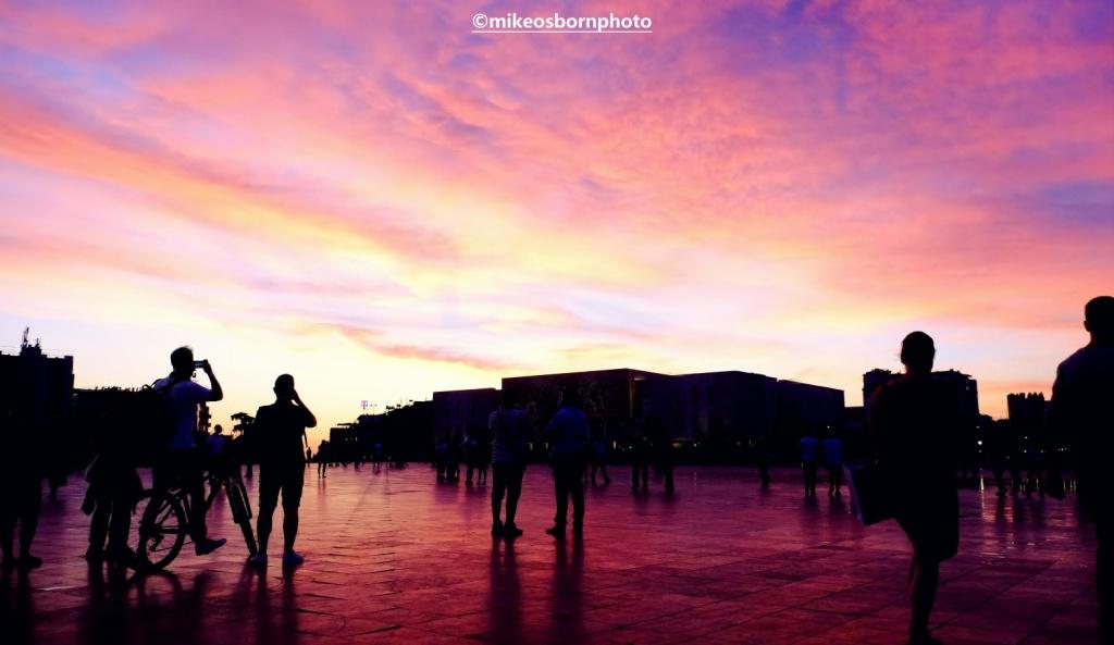 Scarlet sunset over Skanderbeg Square, Tirana, Albania
