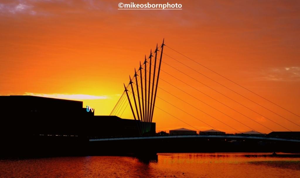 MediaCity footbridge at Salford during a spectacular sunset