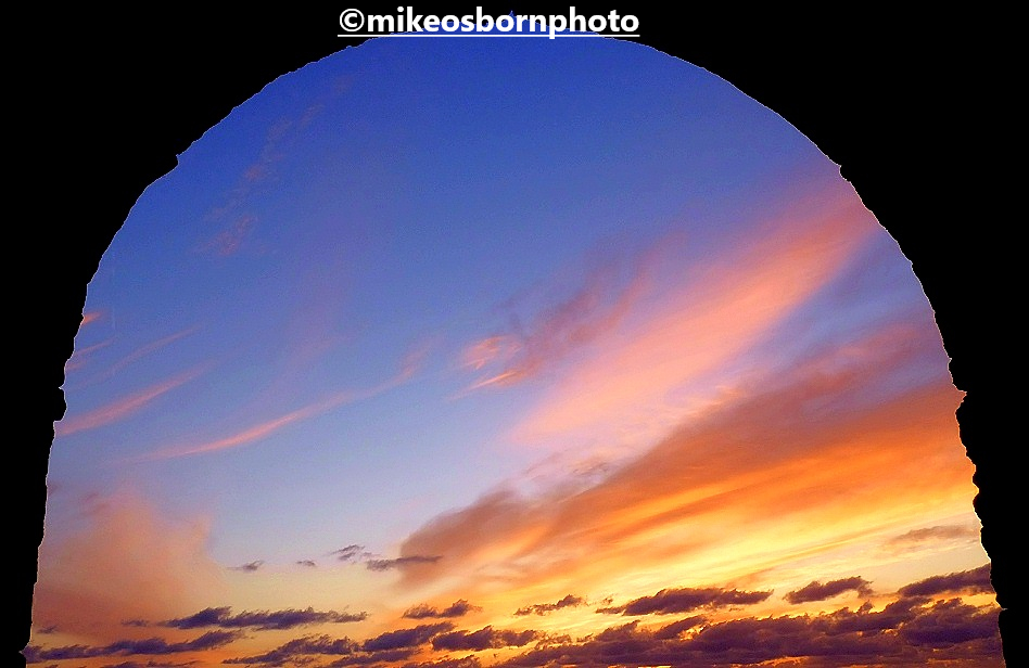 The sunset in Fuerteventura, Canary Islands framed in an arched window