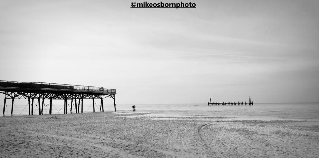 Photographer takes pier photos on St Anne's beach, Lancashire