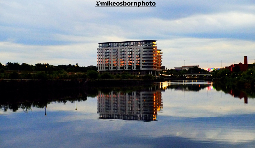 A new apartment block at Pomona, Manchester reflected in the Ship Canal