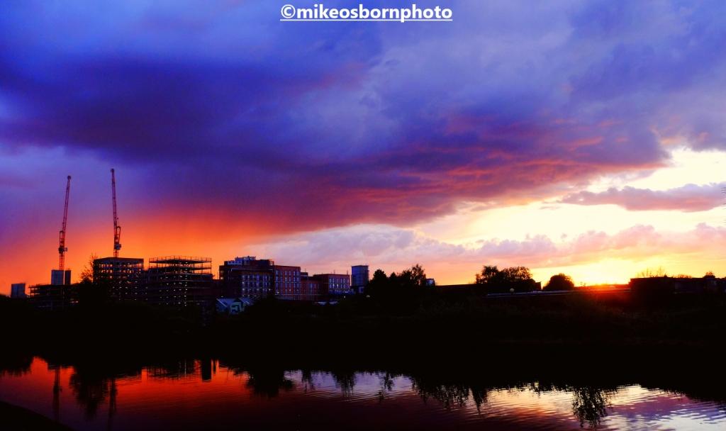 Vibrant sunset along the Bridgewater Canal towards Salford