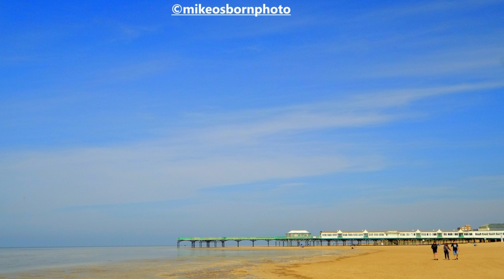 People on the beach at St Anne's, Lancashire, with the pier in the background