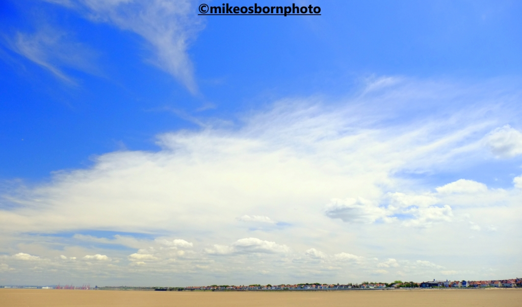 The Wirral town of Hoylake seen from the beach at low tide