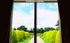 View of formal gardens through window of Shugborough Hall