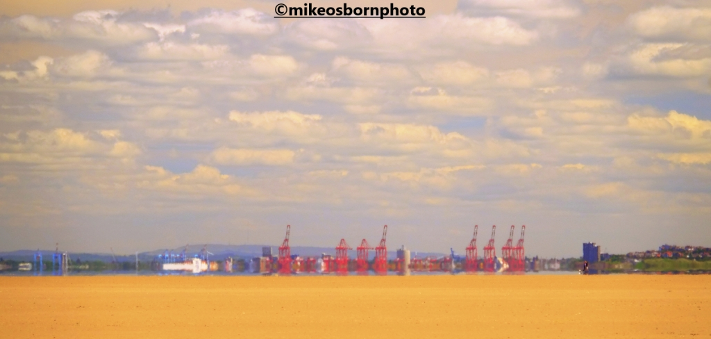 The cranes of the Mersey estuary seen from Hoylake beach, Wirral