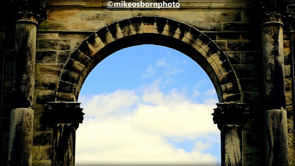 Hadrian's Arch framing blue sky on Shugborough estate