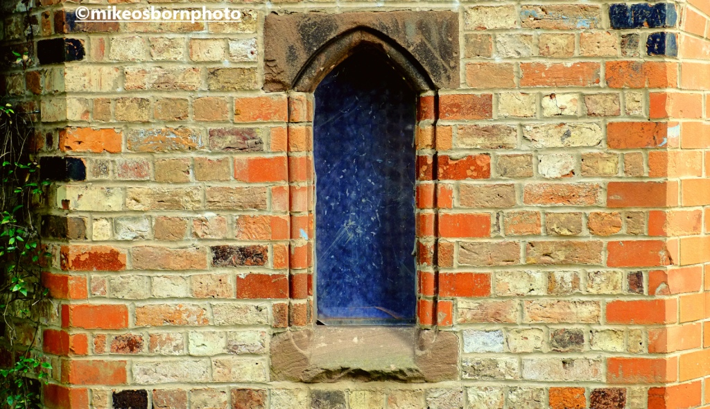 Window of the dovecote at Walkden Gardens, Manchester
