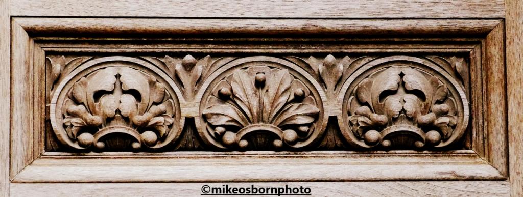 Wooden carving on a door at Bodnant Garden, Wales