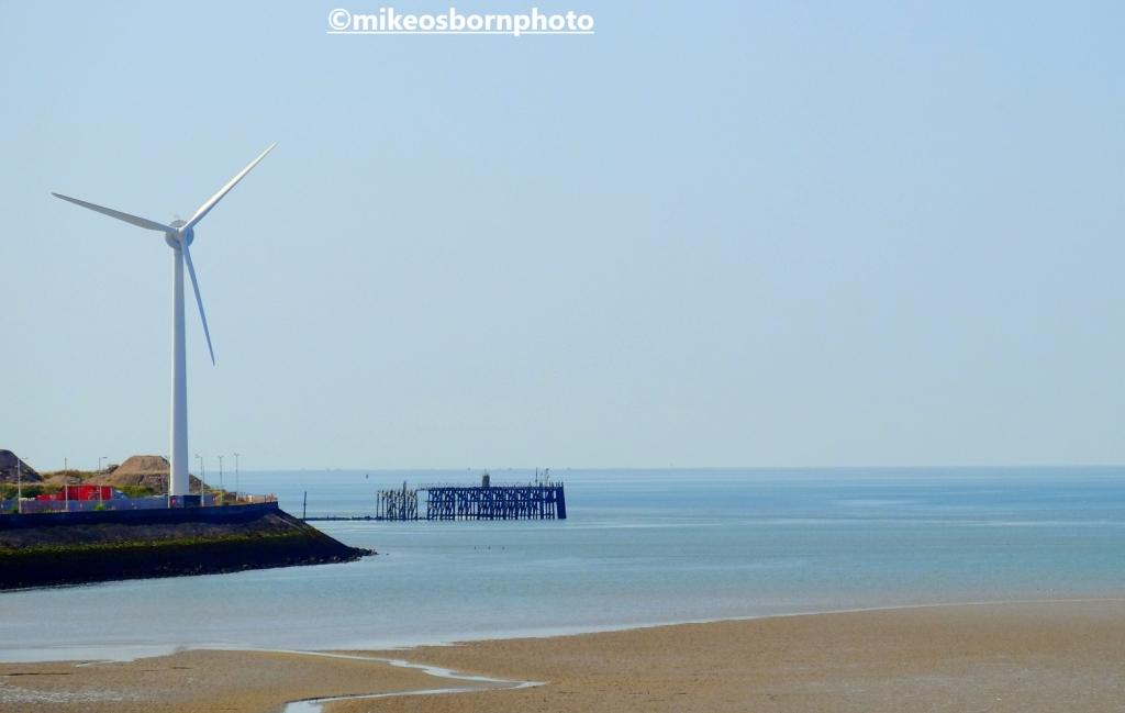 A wind turbine close to Heysham power station