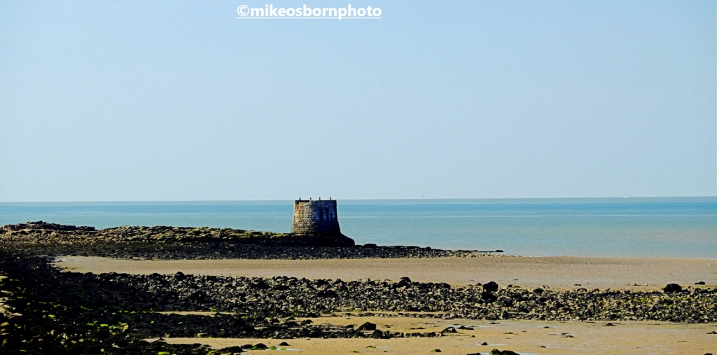 The stump of a lighthouse by the sea at Heysham